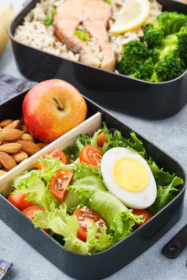 Lunch boxes with food ready to go for work or school. Meal preparation or dieting concept stock photo