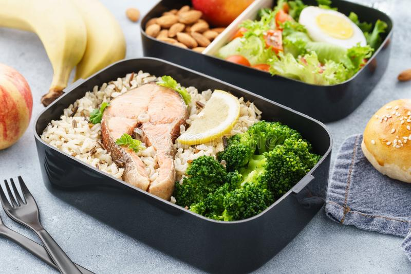 Lunch boxes with food ready to go for work or school. Meal preparation or dieting concept royalty free stock photography