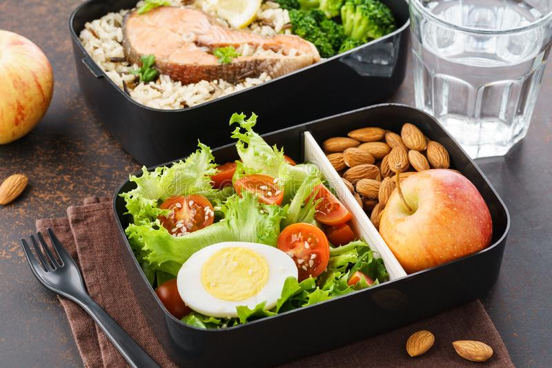 Lunch boxes with food ready to go for work or school. Meal preparation or dieting concept royalty free stock image