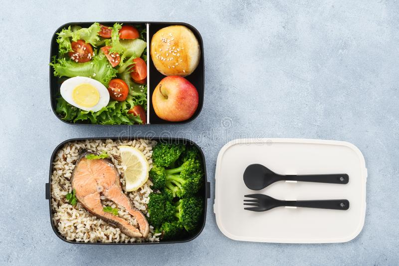 Lunch boxes with food ready to go for work or school. Meal preparation or dieting concept. Space for text stock photo