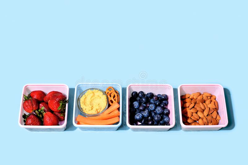 Lunch boxes with fresh raw food, healthy food concept royalty free stock images