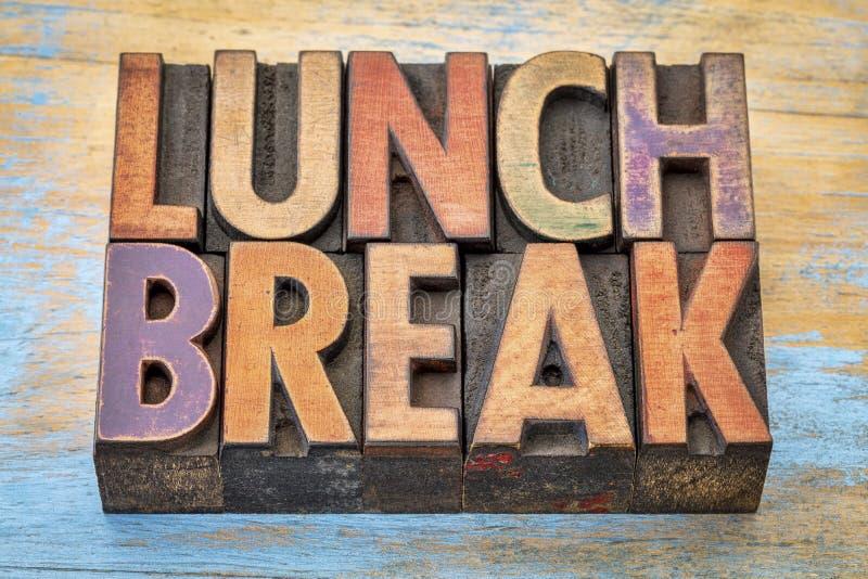 Lunch break banner in letterpress wood type. Lunch break banner - word abstract in vintage letterpress wood type printing blocks against grunge painted wood royalty free stock images