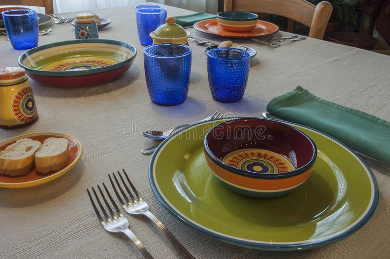 Lunch With Colored Plates stock photography