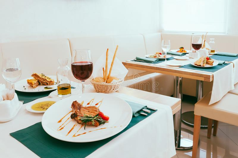 Lunch food served in restaurant, cute setup with meal and wine glasses stock photography