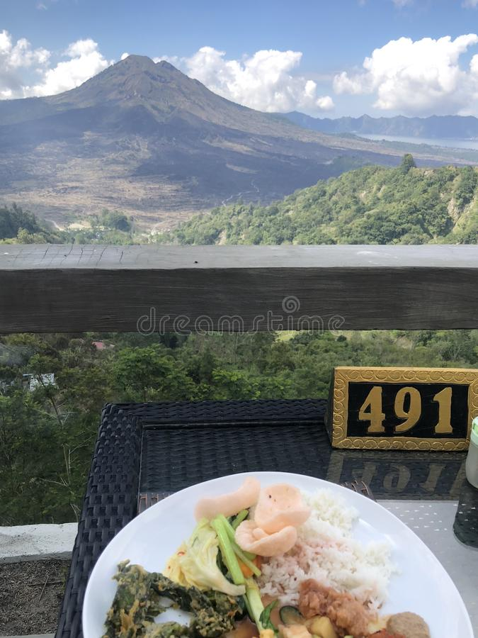 Lunch with Kintamani Volcano view in Bali royalty free stock photos