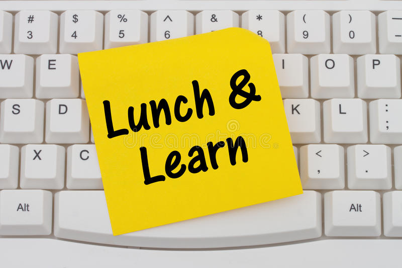 Lunch and Learn, computer keyboard and sticky note. Lunch and Learn, Computer Keyboard with a yellow blank sticky note with text Lunch and Learn royalty free stock photography