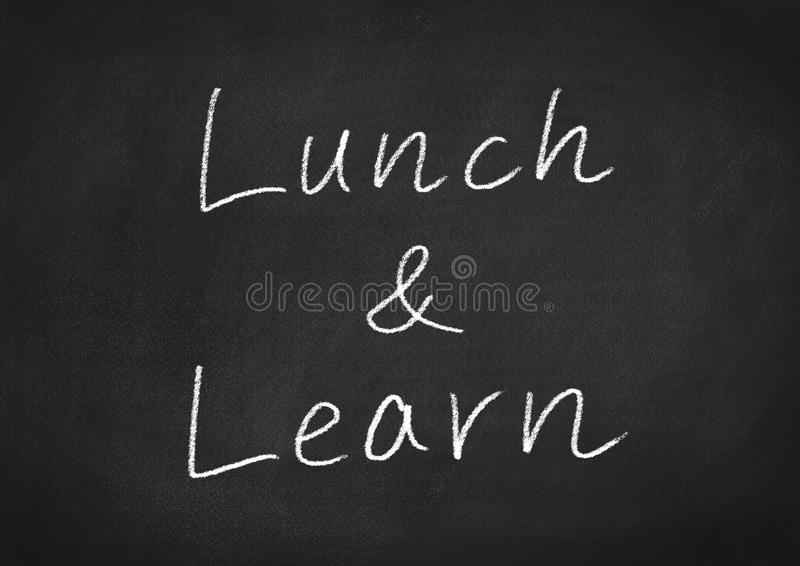 Lunch and learn. Concept words on a blackboard background stock photography