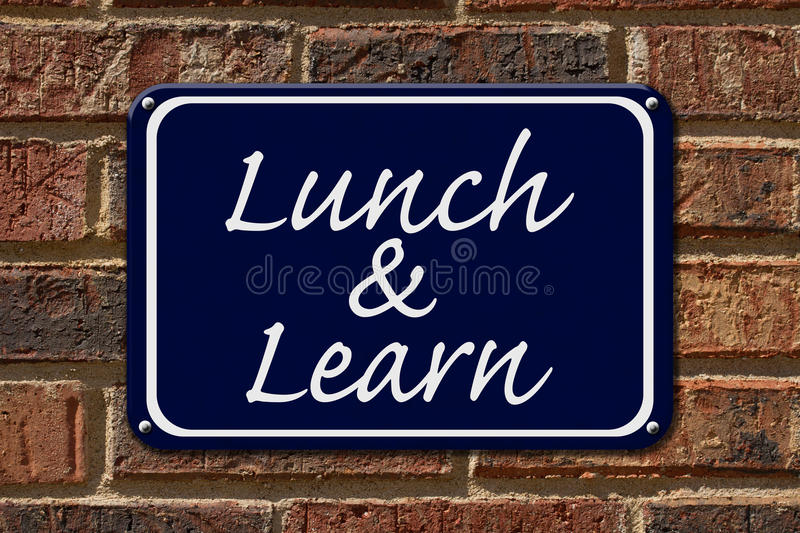 Lunch and Learn Sign. A blue sign with the word Lunch and Learn on a brick wall stock images