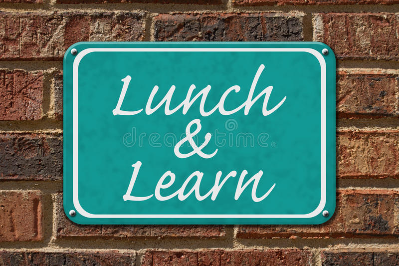 Lunch and Learn Sign. A teal sign with the word Lunch and Learn on a brick wall stock photos