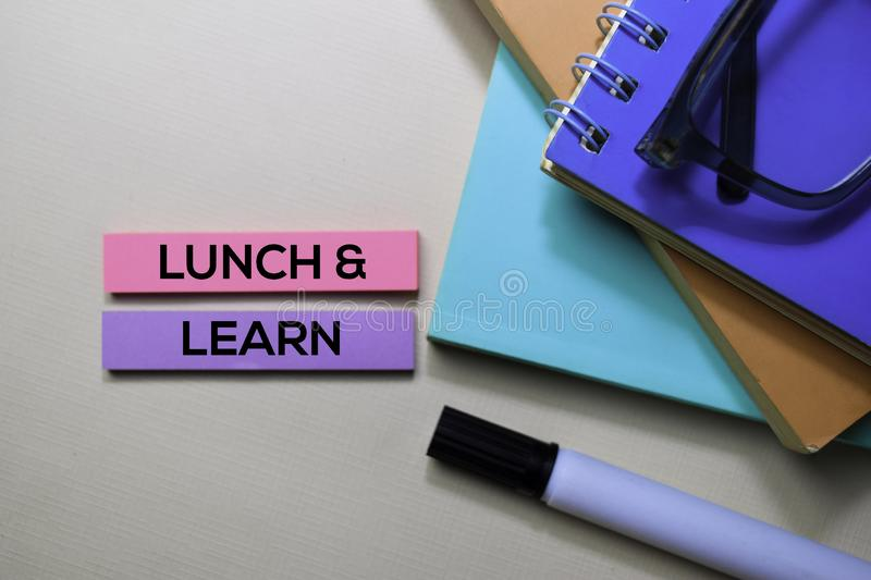 Lunch and Learn text on sticky notes isolated on office desk stock photo