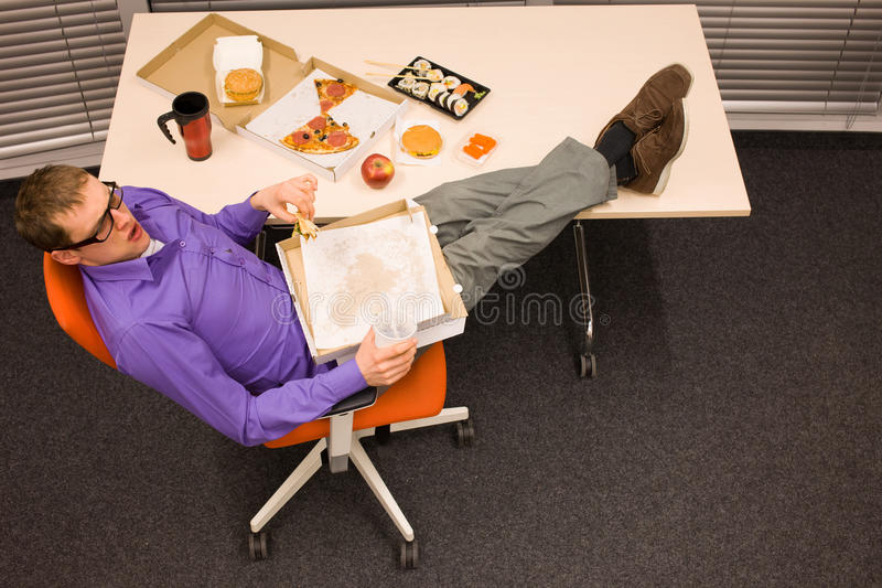 Lunch in office - overeating royalty free stock image