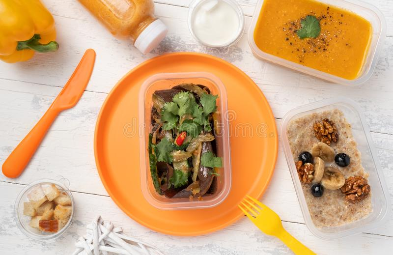 Lunch portion with lentil soup salad and porridge royalty free stock image