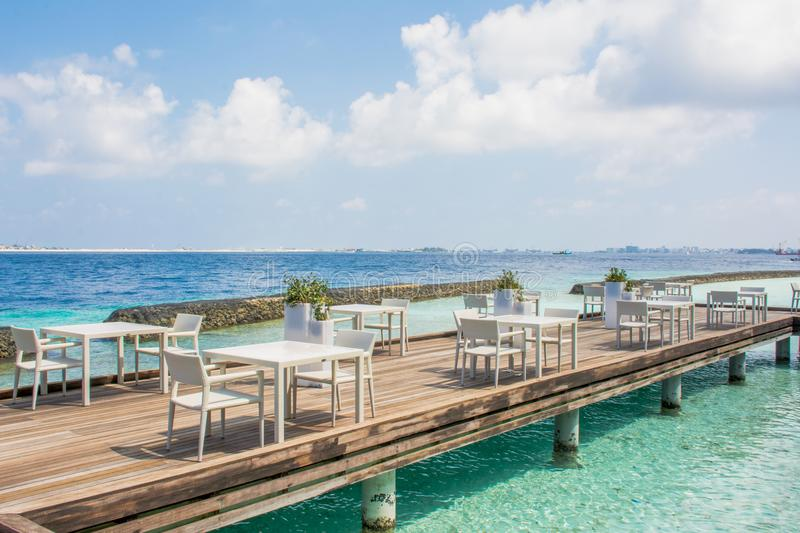 Lunch setup with tables and chairs at the tropical island stock photography