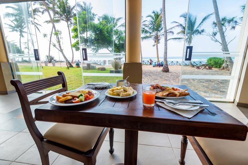 Lunch table served for two with tropical sea view stock photos