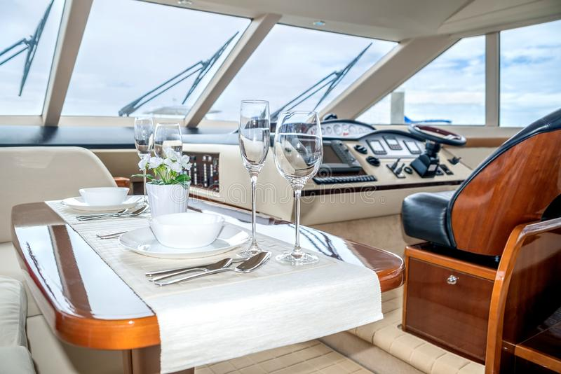Lunch table setting on a yacht interior comfortable royalty free stock photography
