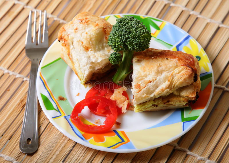Lunch time. Danish pastry in designer plate over wooden background stock image