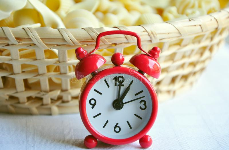 Lunch time concept. Pasta time concept with a red clock. crave, craving hour concept royalty free stock photography