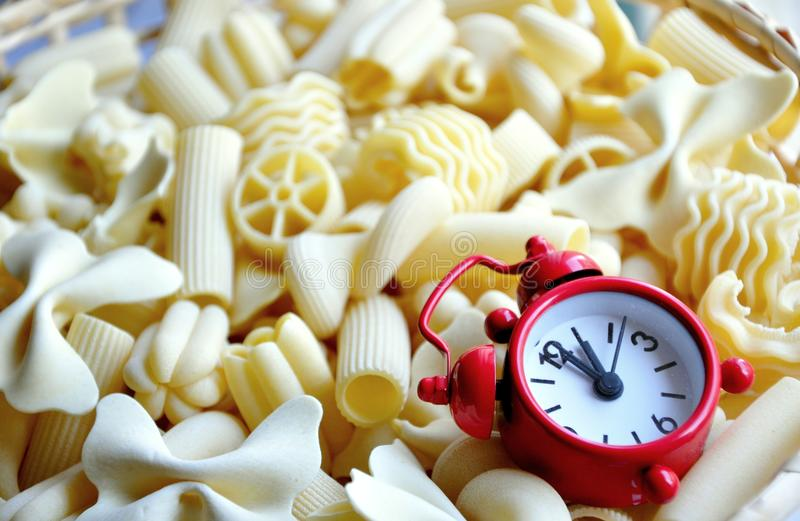Lunch time concept. Pasta time concept with a red clock. craving , crave concept royalty free stock images
