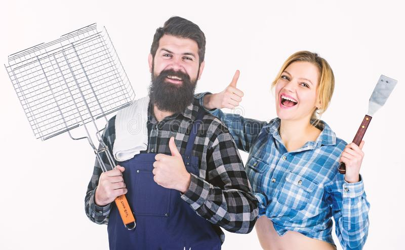 Lunch time. Couple in love hold kitchen utensils. Tools for roasting meat. Man bearded hipster and girl. Preparation and stock image