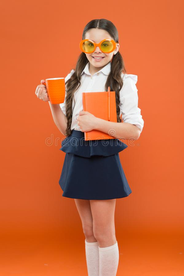 Lunch time. happy school girl in uniform and party glasses. small child with notebook. reading education. writing in. Workbook. children literature. get stock photo