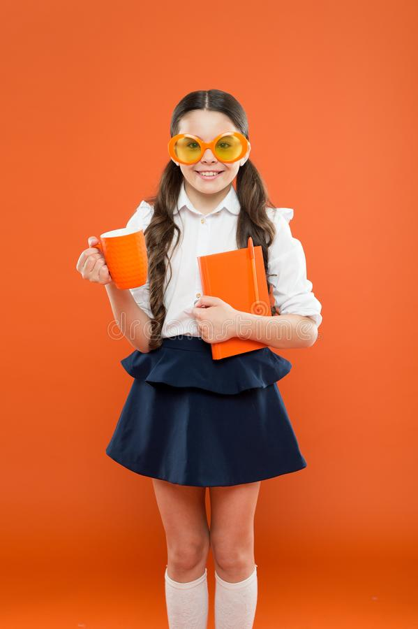 Lunch time. happy school girl in uniform and party glasses. small child with notebook. reading education. writing in. Workbook. children literature. get royalty free stock photo