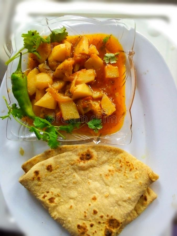 Lunch time Pakistani food cooked potato gravy with roti chapati Indian Pao bhaji stock images