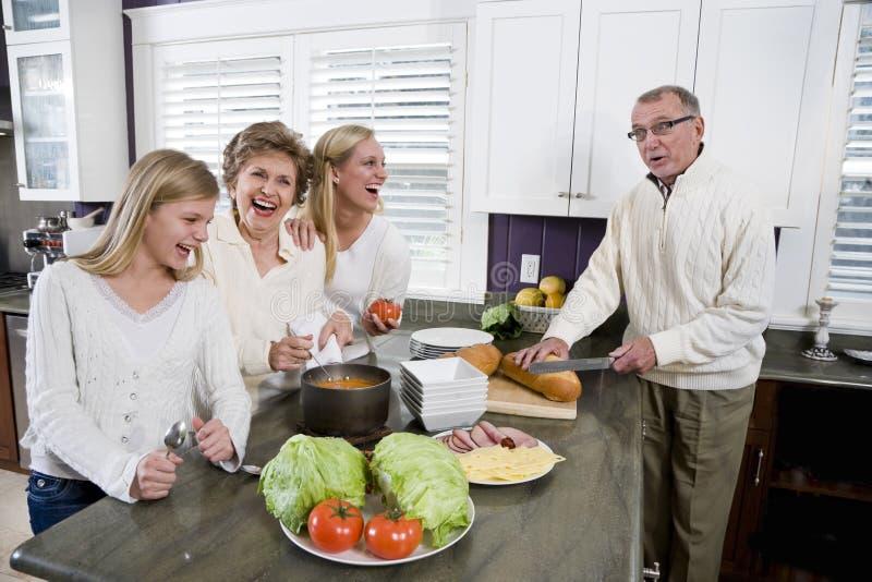 lunch tre för kök för matlagningfamiljutveckling arkivfoto