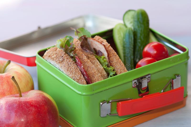 Lunchbox with sandwich and vegetables. stock photos