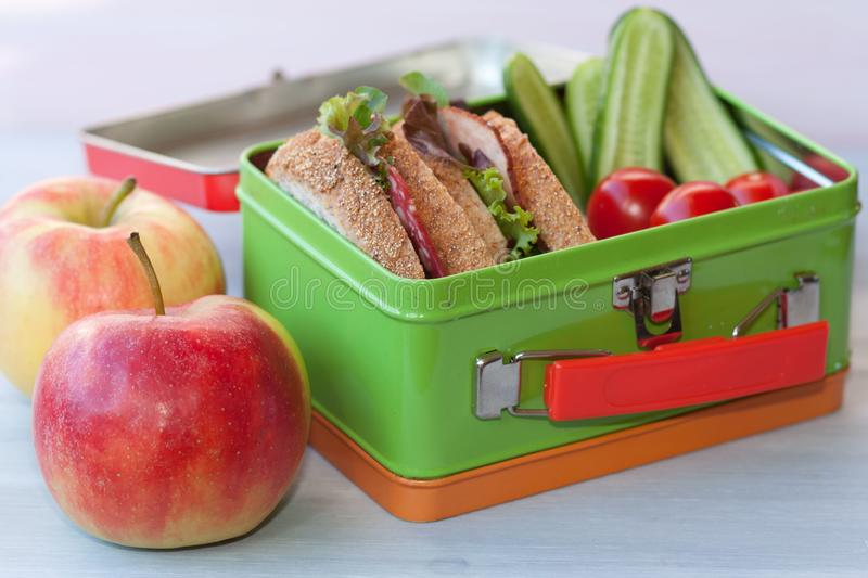 Lunchbox with sandwich, vegetables and fruits. royalty free stock photography