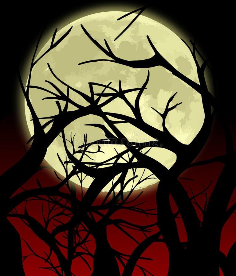 Lune en silhouette d'arbres image libre de droits