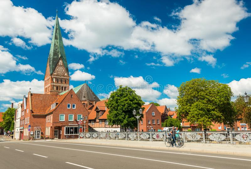 Luneburg, Germany: People walking along the bridge royalty free stock image
