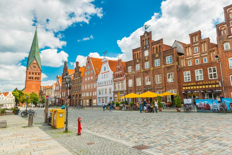 Luneburg, Germany: View of the central street with old brick houses stock images