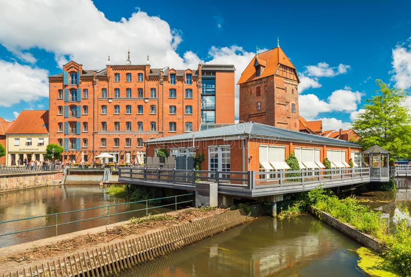 Luneburg, Germany: Historical buildings and modern restaurant build on the water stock photography