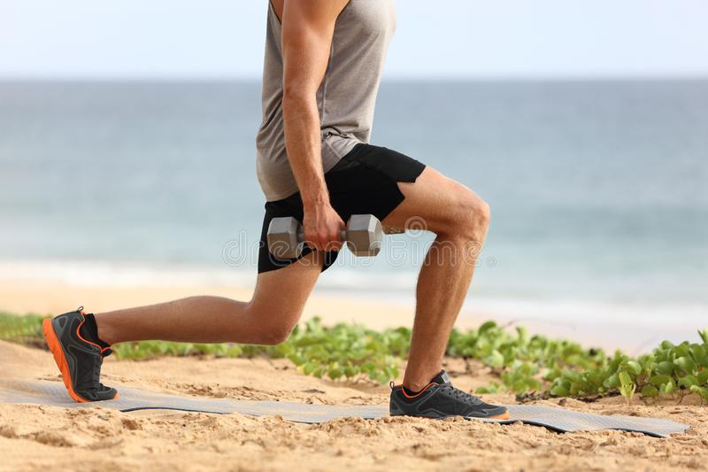 Lunge leg workout with dumbbells weights. Fitness man doing lunges training legs on beach summer outdoors with weight. Healthy lifestyle stock images