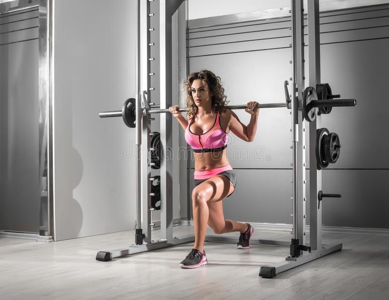 Lunges at Smith machine stock photo