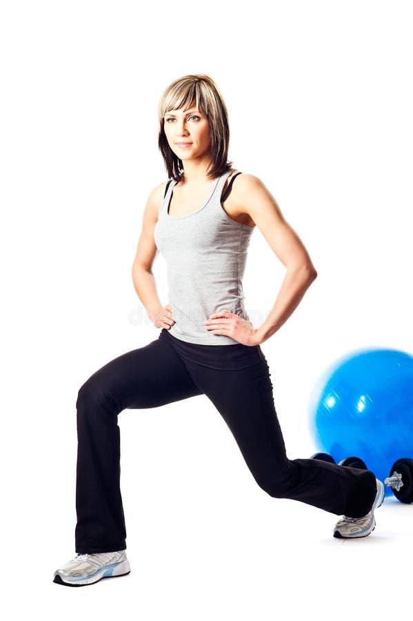 Lunging do Sportswoman fotografia de stock royalty free
