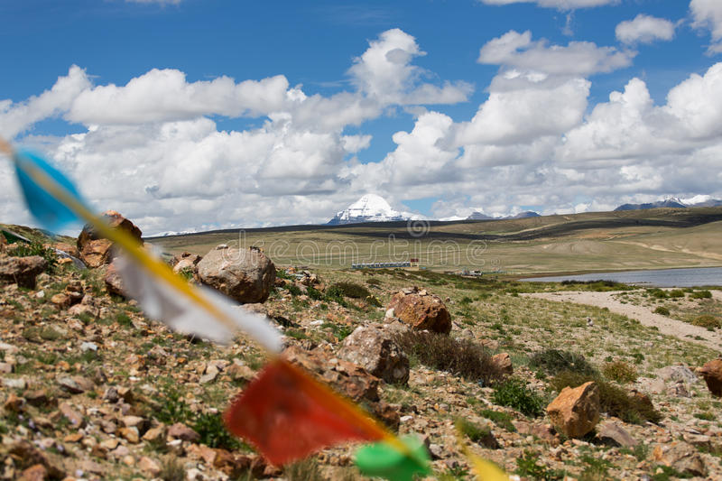 Lungta and Holy Kailas view from Manasarovar lake Tibet. Holly Kailash - the holiest mountain of Tibet. Object of pilgrimage of buddhist, hindu, jains and adepts royalty free stock photography