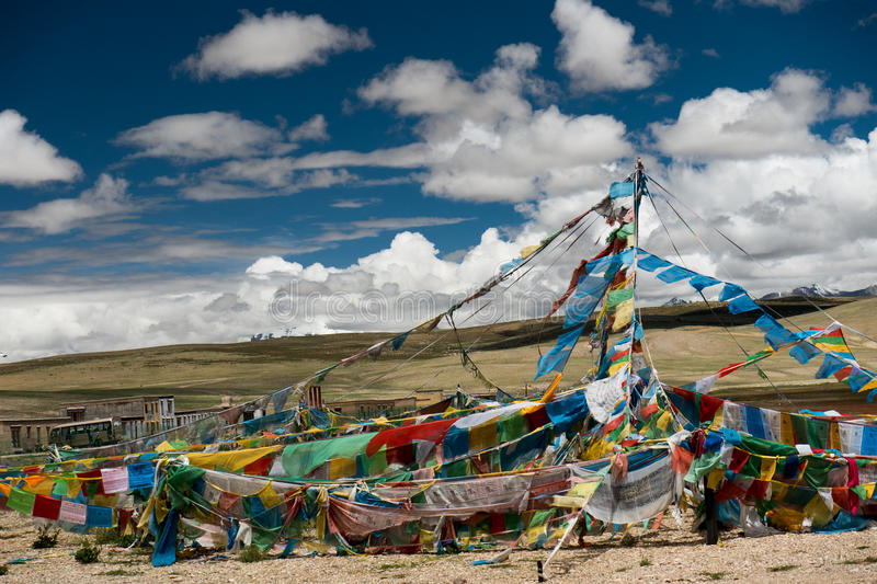 Lungta and Holy Kailas view from Manasarovar lake Tibet. Holly Kailash - the holiest mountain of Tibet. Object of pilgrimage of buddhist, hindu, jains and adepts stock photos