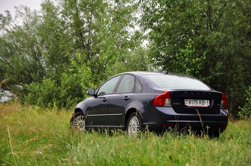 A car is parked on the grass outside the city. Luninets, Belarus - June 23, 2019: a car is parked on the grass outside the city royalty free stock images