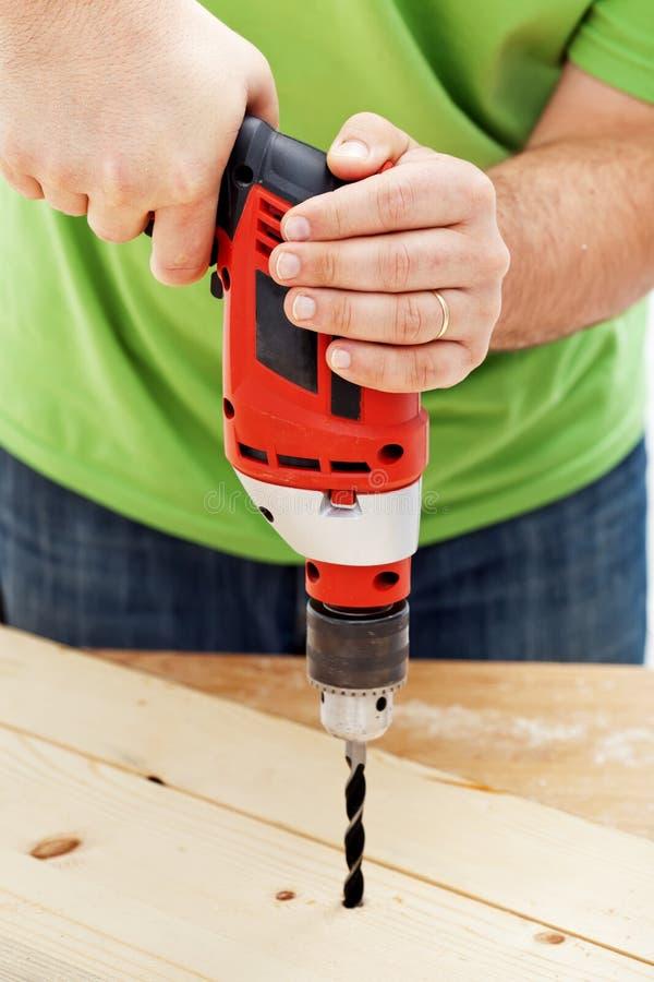 Luogo di perforazione del falegname o del carpentiere fotografia stock libera da diritti
