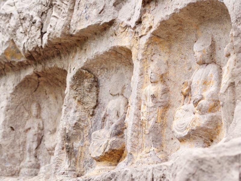 Luoyang Longmen grottor bruten Buddha och de stengrottorna och skulpturerna i de Longmen grottorna i Luoyang, Kina Taget i 14th fotografering för bildbyråer