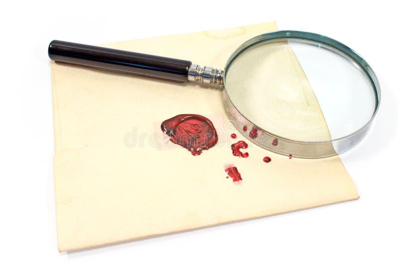 Lupa antigua en letra sellada cera fotos de archivo