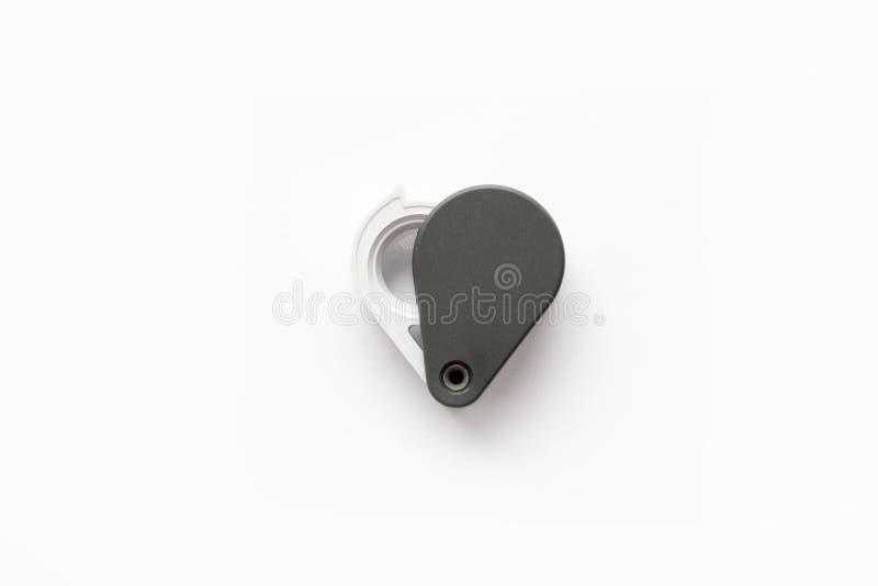 A lupa para diamantes ou vê o amuleto isolado em um fundo branco fotografia de stock royalty free