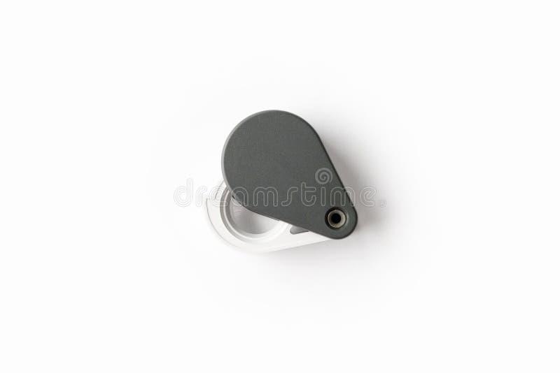 A lupa para diamantes ou vê o amuleto isolado em um fundo branco fotos de stock royalty free