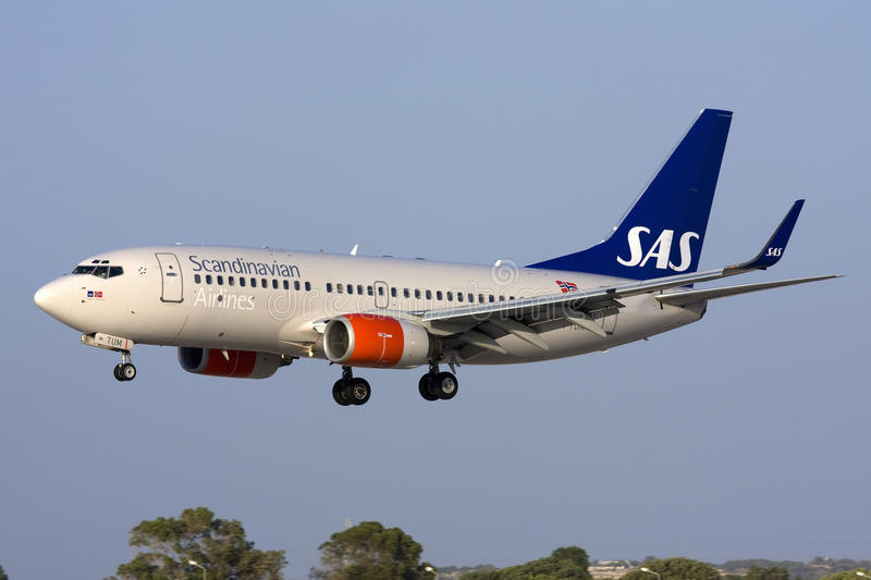 Luqa Malta, 9 August 2008: SAS 737 landing 31. Scandinavian Airlines Boeing 737-705 is seen on short finals for runway 31. The 737 is the most popular short to stock photography