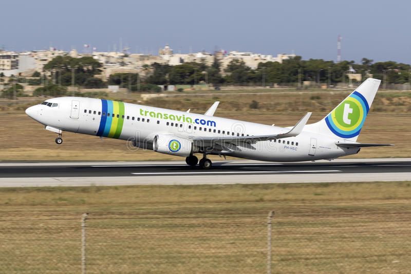 Luqa, Malta 12 June 2015: 737 take off. Transavia Airlines Boeing 737-8K2 taking off from runway 13. The Boeing 737 is the most popular medium haul airliner royalty free stock photo