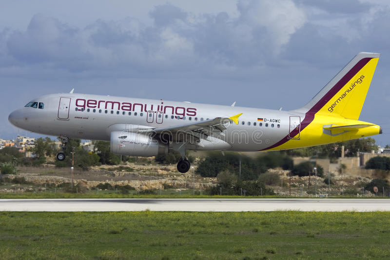 Luqa, Malta 20 October 2007: Germanwings Airbus A319 arrives in Malta. Germanwings Airbus A319-132 landing runway 14. Old silver colour scheme royalty free stock images