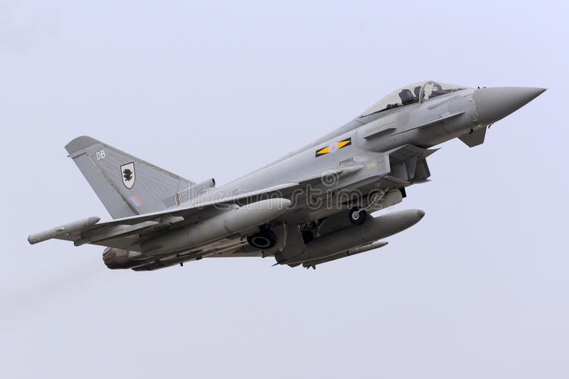 Luqa, Malta - 20 October 2015: RAF Typhoon takes off. Royal Air Force Eurofighter EF-2000 Typhoon FGR4 taking off runway 13 with another 3 Eurofighters. Arrived royalty free stock photos
