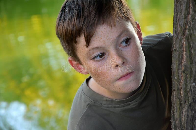 Lurking boy stock photo