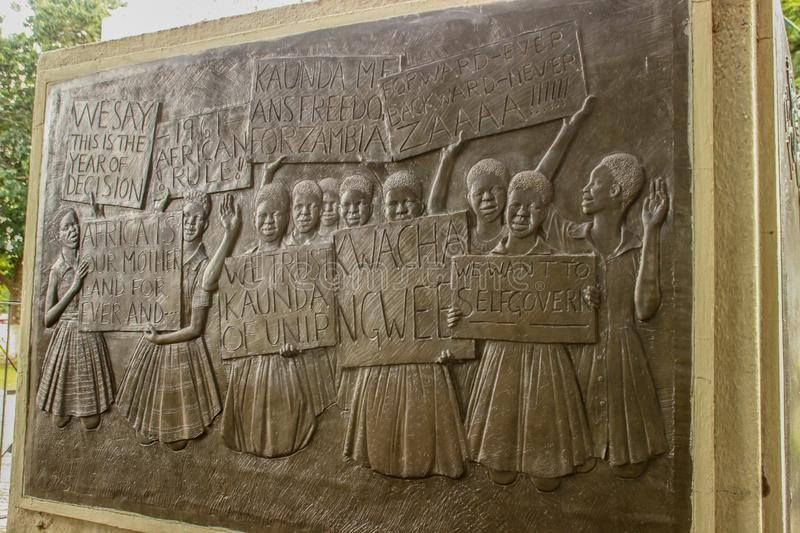 Bas-relief element of the monument of independence depicting women in the city center stock images